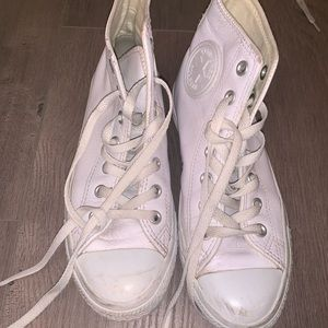 All white leather converse hightop sneakers